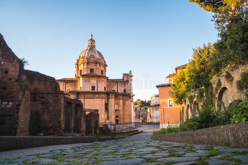 View of a Roman street with a nice historic architecture near the Forum one morning, Rome, Italy royalty free stock images