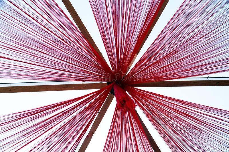 View of the roof from the bottom of the divergent rays of red ropes. royalty free stock photos