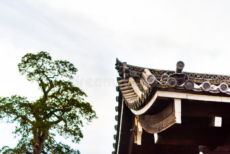 View of the roof in the Japanese style on a background of the sky, Kyoto, Japan. Copy space for text. royalty free stock photos