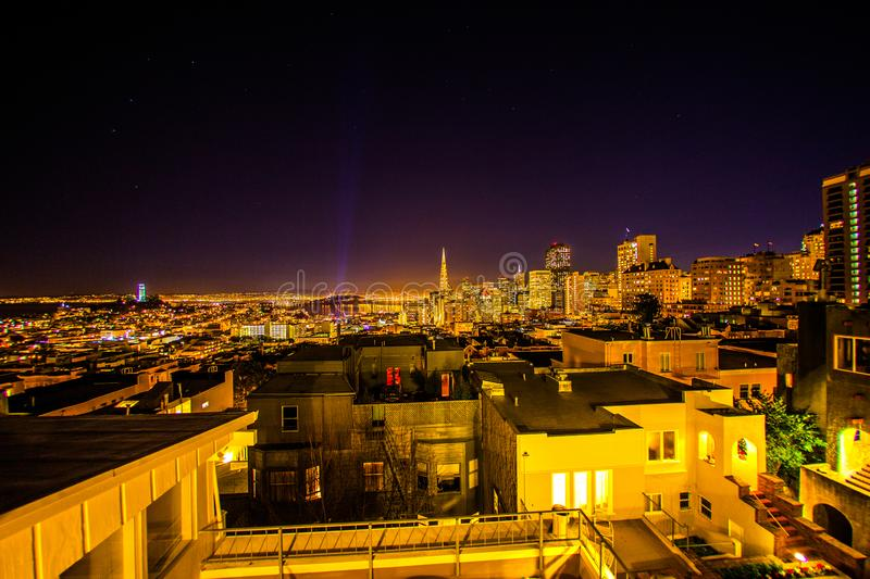 A view from the roof terrace at night shows san francisco and ro stock photos