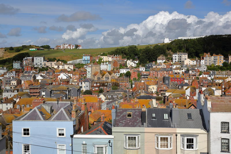 View of the roofs of Hastings old town from East Hill with West Hill in the background and beautiful clouds, Hastings, UK. View of the roofs of Hastings old town royalty free stock images