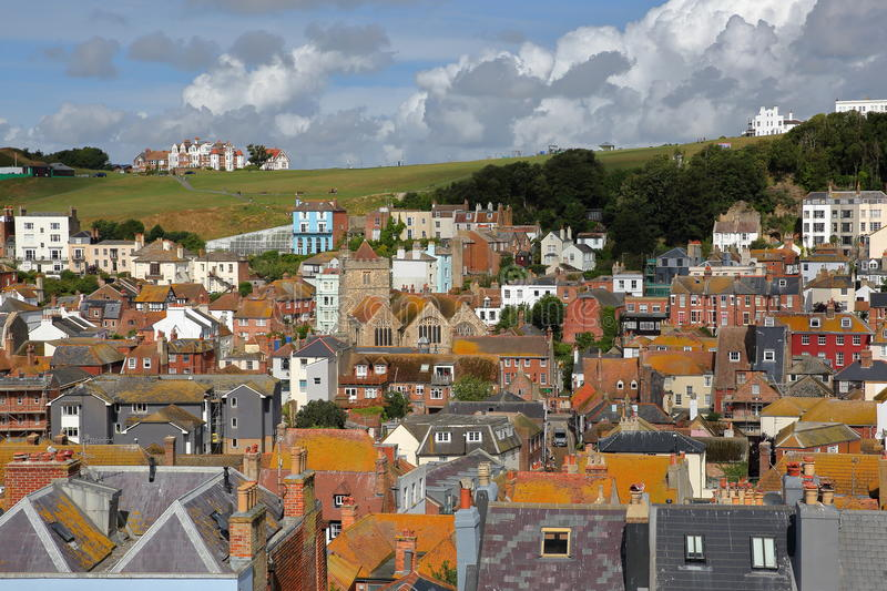 View of the roofs of Hastings old town from East Hill with West Hill in the background and beautiful clouds, Hastings, UK. View of the roofs of Hastings old town stock photo