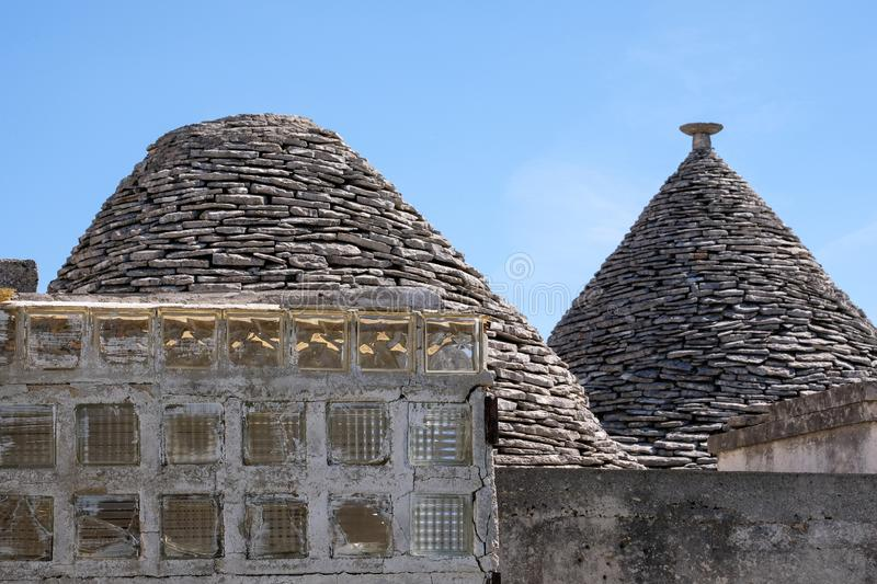 View of roofs of traditional trulli houses in the Aia Piccola residential area of Alberobello in the Itria Valley, Puglia Italy. View of roofs of traditional royalty free stock photos