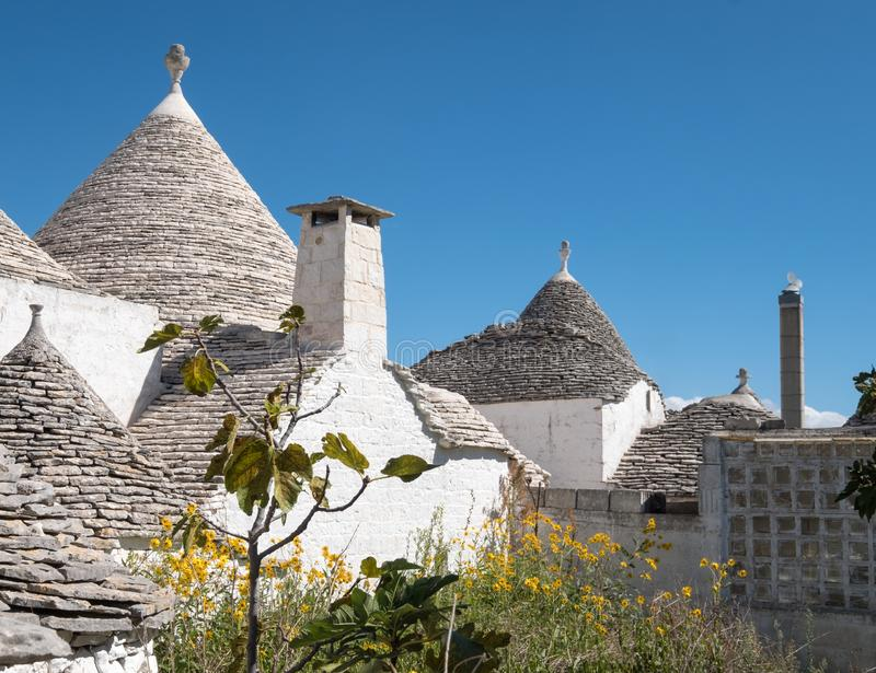 View of roofs of traditional trulli houses in the Aia Piccola residential area of Alberobello in the Itria Valley, Puglia Italy. View of roofs of traditional royalty free stock photography