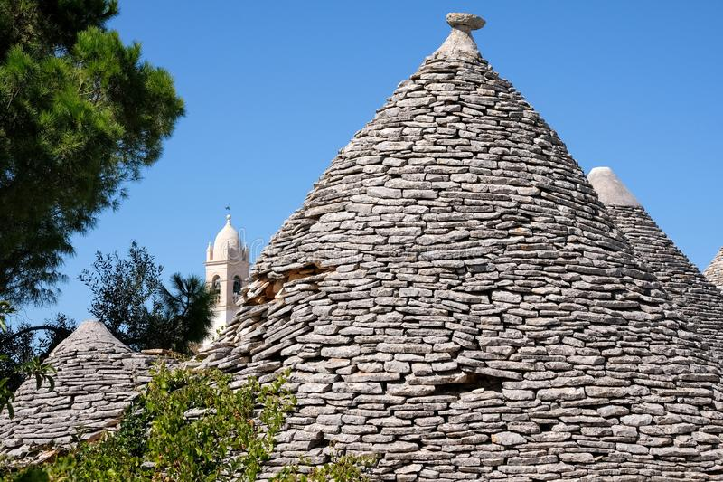 View of roofs of traditional trulli houses in the Aia Piccola residential area of Alberobello in the Itria Valley, Puglia Italy. View of roofs of traditional stock images