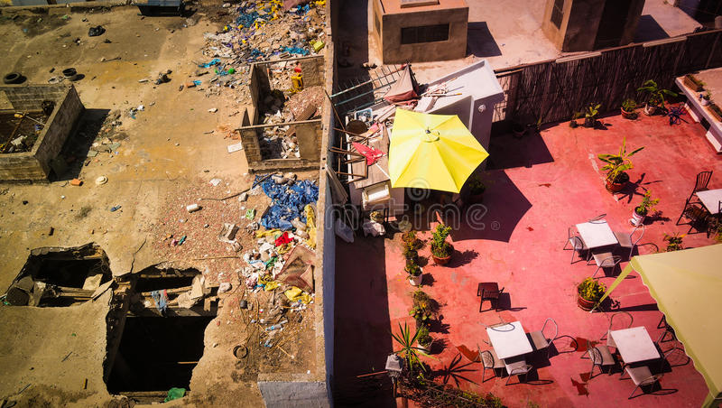 View from rooftop in Casablanca, Morocco with division of rich and poor. Looking down at the disparity between rich and poor in urban Morocco stock image