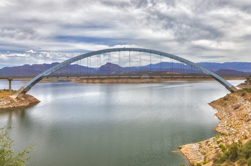 View of Roosevelt lake and bridge, Arizona. View of Roosevelt Lake and a bridge which are located at Apache trail scenic drive in Arizona, close to Phoenix. View stock photos