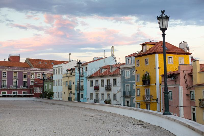 View of a row of colorful houses near the National Pantheon in Lisbon. Portugal, at sunset stock photos