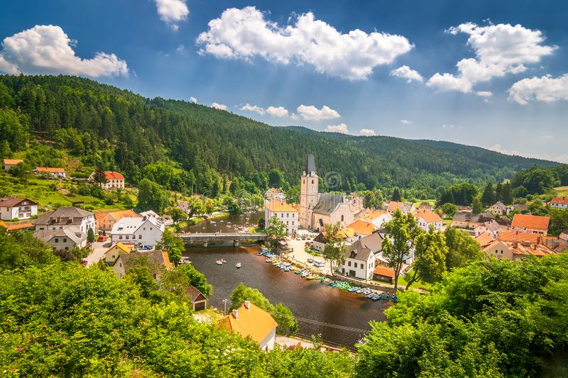 View of the Rozmberk nad Vltavou town with a rafting on Vltava stock image