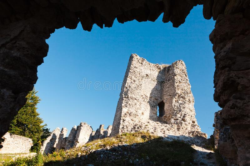 View on ruined walls of old medieval castle - Framed naturally. View on ruined walls of old medieval castle. Framed naturally with rocks of entering gate royalty free stock photos