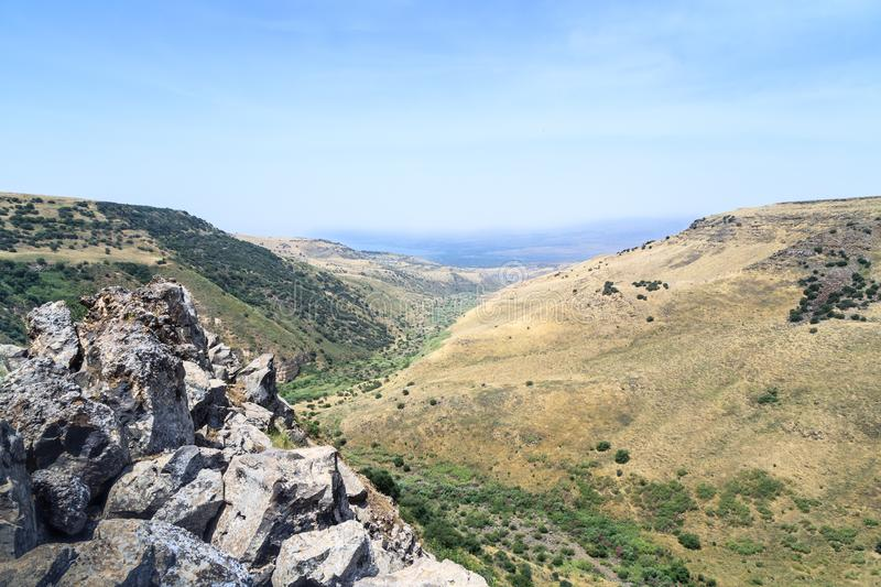 View from the ruins of the ancient Jewish city of Gamla destroyed by the armies of the Roman Empire in the 67th year AD to the Gol. An Heights and to the Sea of stock photo