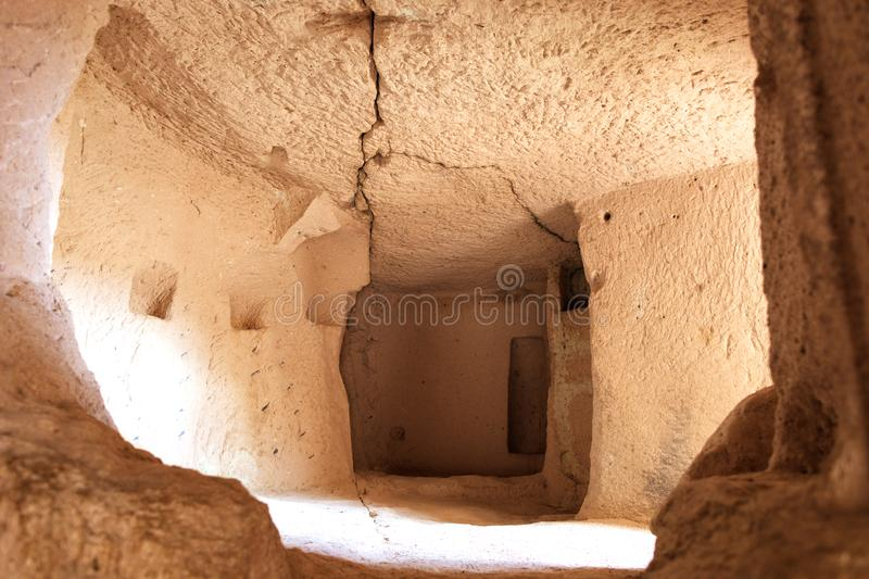 View of the ruins of ancient living quarters in the cave caves of old sandstones in the valleys of Cappadocia royalty free stock photography
