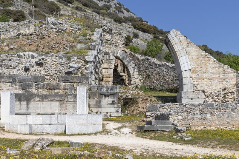 Ruins of The ancient theatre in the Antique area of Philippi, Eastern Macedonia and Thrace, Greece. View of ruins of The ancient theatre in the Antique area of stock photography