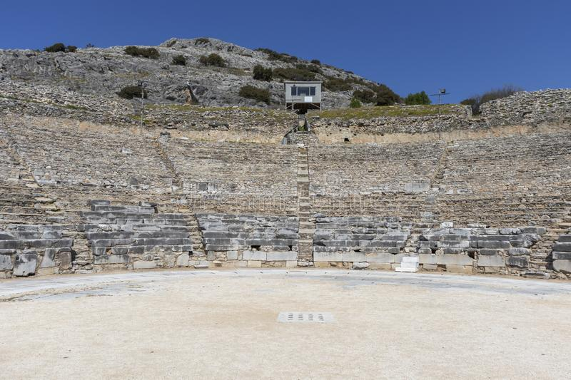 Ruins of The ancient theatre in the Antique area of Philippi, Eastern Macedonia and Thrace, Greece. View of ruins of The ancient theatre in the Antique area of stock photos