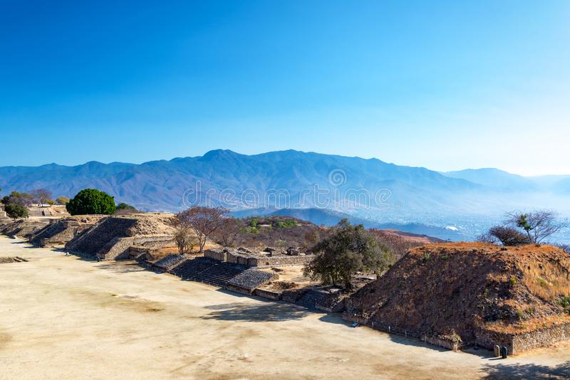Ruins and Hills. View of ruins in Monte Alban with hills rising in the background in Oaxaca, Mexico stock photography