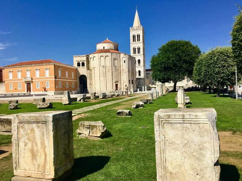 A view of the ruins of the roman forum with the Church of St Donatus in the background, in Zadar, Croatia. stock image