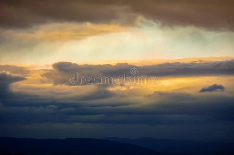 View of a rural landscape of central Italy under a fiery sky stock photos