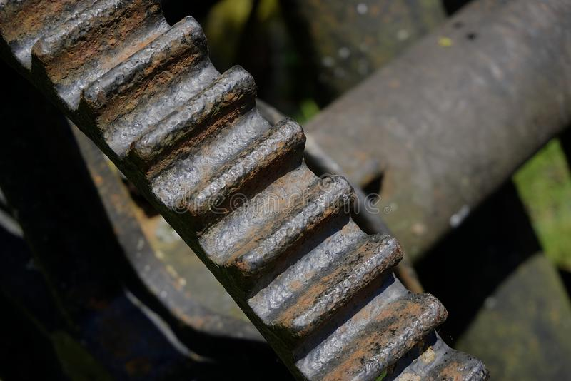 Rusty Old Drive Cog. View of rust old drive cog part of redundant machinery stock photo