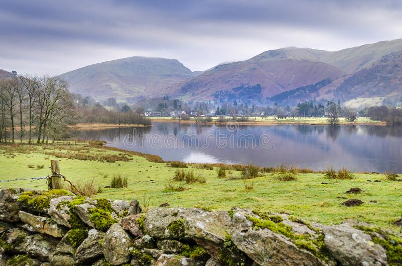 A view of Rydal water from the road with the Langdales. Range of mountains in the background royalty free stock images
