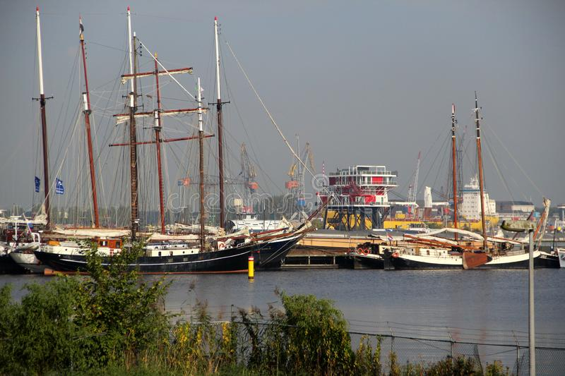 View on the sail boat and the ships in close up at the harbor in amsterdam netherlands stock photos