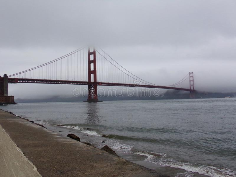 San Francisco Golden Gate Bridge disappearing in the fog stock photo