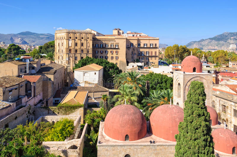 View from San Giovanni degli Eremiti - Palermo. The famous red domes of the Church of St. John of the Hermits San Giovanni degli Eremiti and the Norman Palace stock photography
