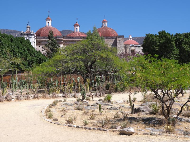 View of San Pedro church in Mitla city, path at archeological site of Zapotec culture in Oaxaca landscape in Mexico. View of San Pedro church in Mitla city, path stock photography