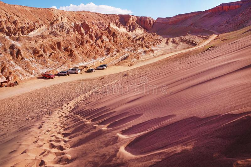 View of sand dunes and rocky hills in the Mars Valley near San Pedro de Atacama against a blue dramatic sky. Desert landscape of the Mars Valley in red and royalty free stock image