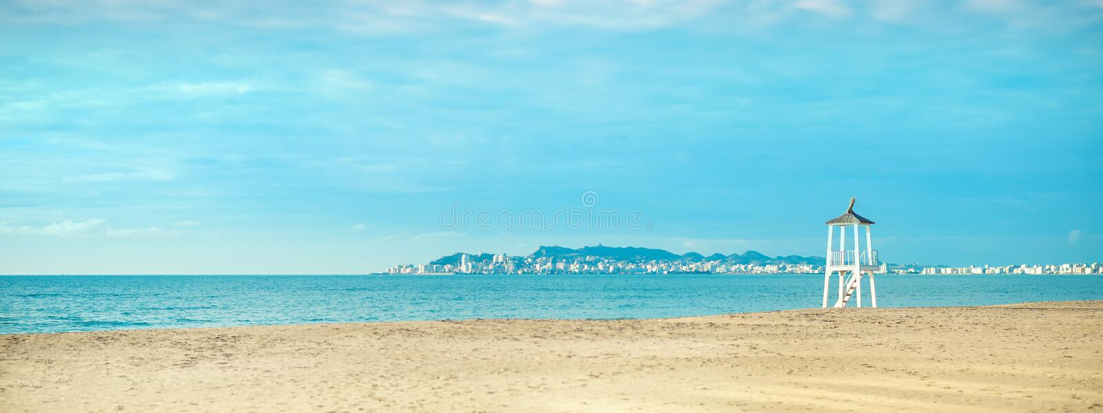 View of the sandy beach of the sea coast. Sunset sky, Durres, Albania. Banner. View of the sandy beach of the Adriatic sea coast with turquois sky and qater stock image