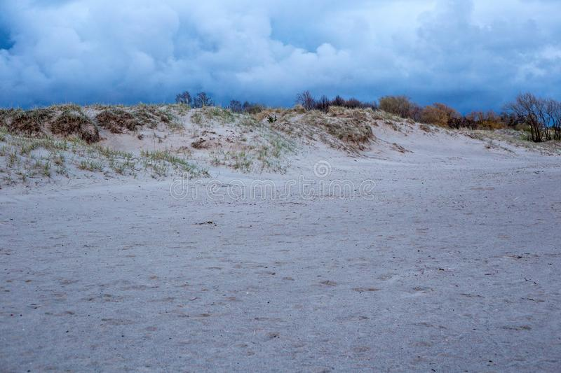 View of the sandy shore of the Parnu bay. In evening. It a bay in the northeastern part of the Gulf of Livonia Gulf of Riga of Baltic Sea, in southern Estonia royalty free stock photo