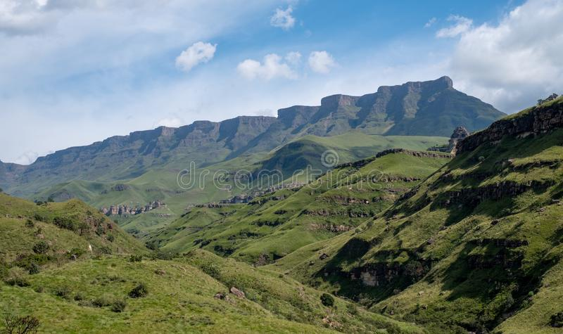 View of the Sani Pass, dirt rural road though the mountains which connects South Africa and Lesotho. stock photo