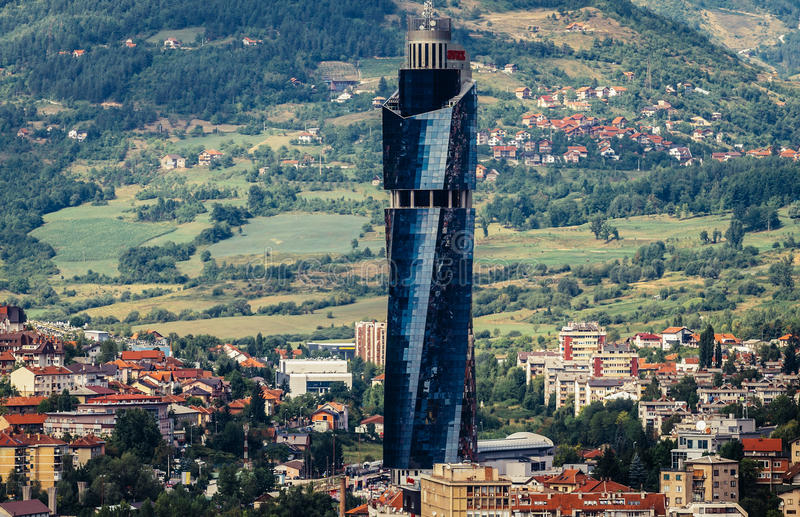 View of Sarajevo. Sarajevo, Bosnia and Herzegovina - August 24, 2015. View from Vraca Memorial Park with building of Avaz Twist Tower royalty free stock photo