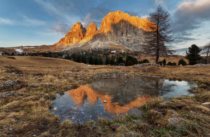 View of Sasso Piatto at dawn - Plattkofel from Passo Sella, part of the Dolomites in South Tyrol, Italy royalty free stock image
