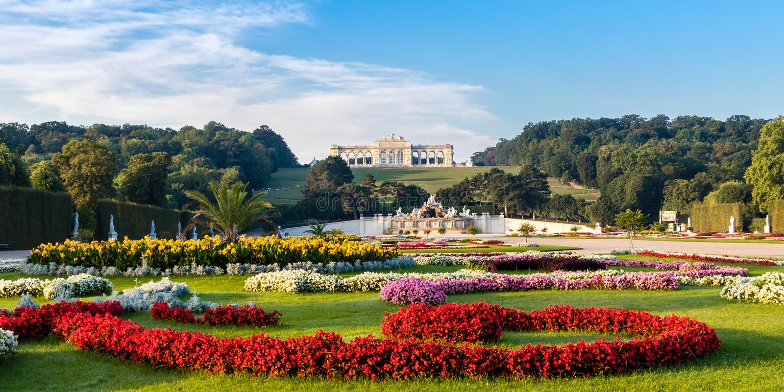 View on Schonbrunn Palace and garden with colorful flowers in Vienna, Austria. Vienna, Austria - September 3, 2019: View on Schonbrunn Palace and garden with stock photo