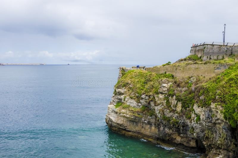 View of the sea and cliffs in Gijon, Asturias, Spain stock photography