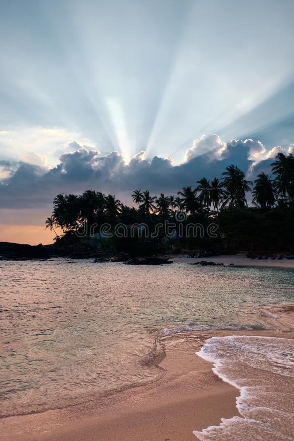 View of Sea in the Evening and a Beautiful Cloud. Morning Panoramic of a Wild Exotic Coast and Coconut Palms. Golden Rays of the Sun above Tropical Island stock images