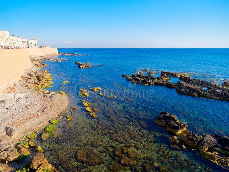 View of the sea and a fragment of Alghero defensive walls. Sardinia. stock images