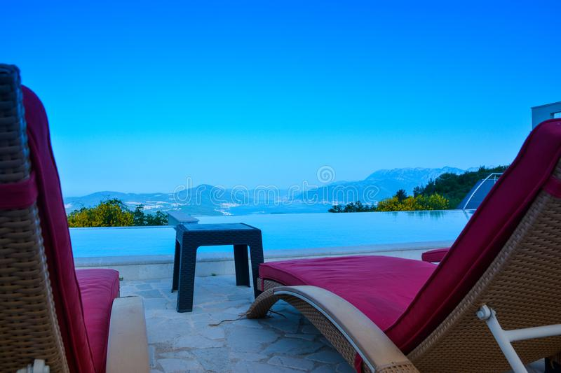 View of the sea and free sun beds against the blue sky.  royalty free stock photography