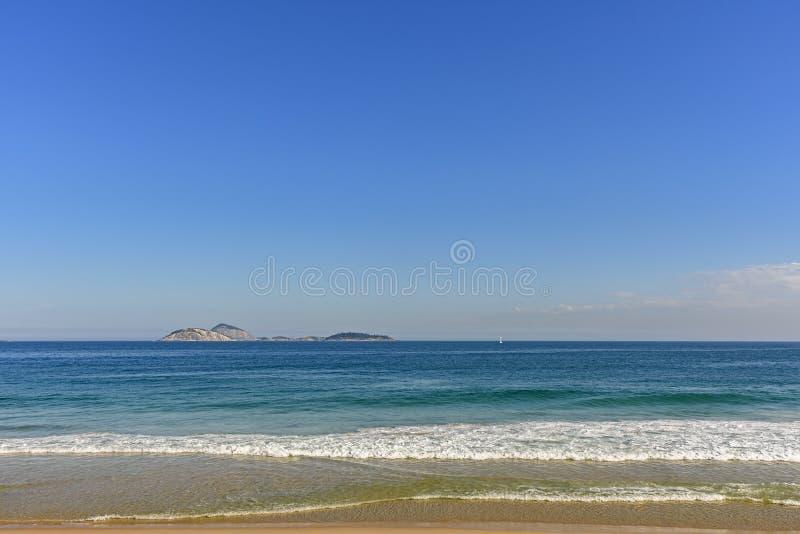 View of sea, horizon line and Cagarras islands. In front off Ipanema beach in Rio de Janeiro royalty free stock image
