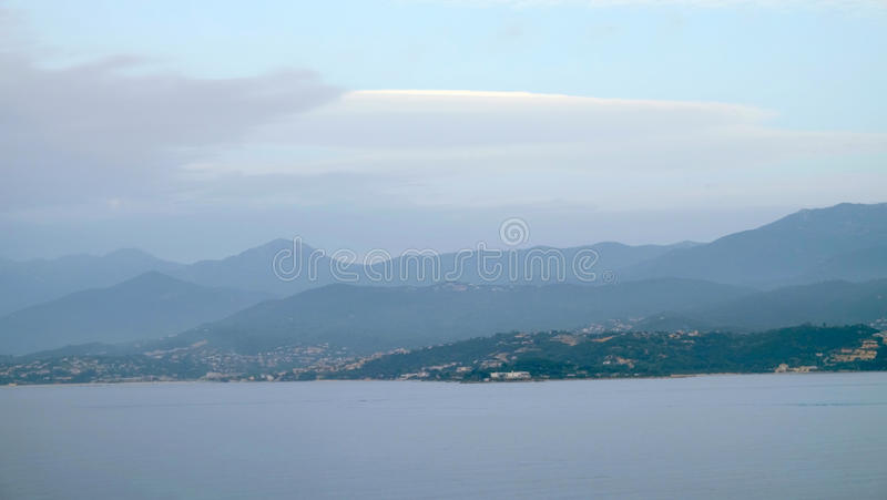View on the sea and the island Corsica, France. View on the sea and the island Corsica in the evening with chain of mountains like backstage, France stock photography