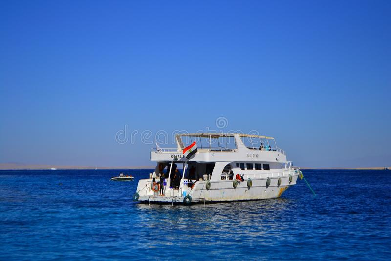 View at the sea shore with white yacht near resort for summer vacation,Sharm El Sheikh, Egypt, January 6, 2019. N royalty free stock images