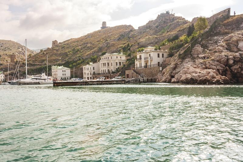 The view from the sea to the ancient town of Balaklava, an old ruined buildings stock images