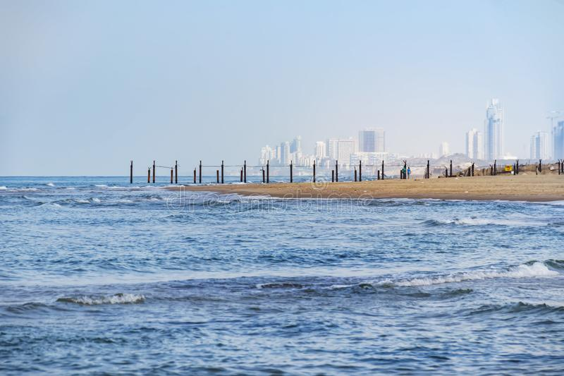 View from the sea to the cape and high-rise buildings stock photo