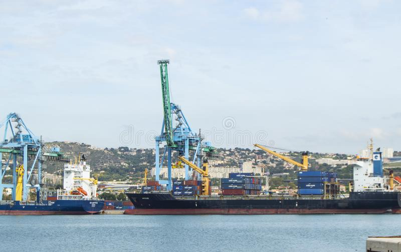 View from the sea to the industrial Harbor of Marseille with cargo cranes, ships and terminals. The largest commercial port in the royalty free stock image