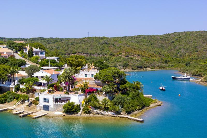 View from sea to small town in Balearis Minor, moored boats, boats and yachts, Menorca, Spain stock images