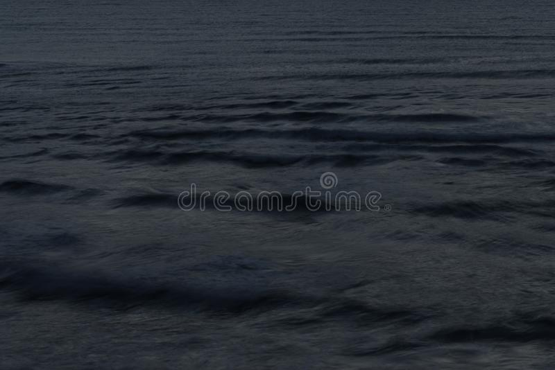 View of the sea wave with a long exposure at night stock images