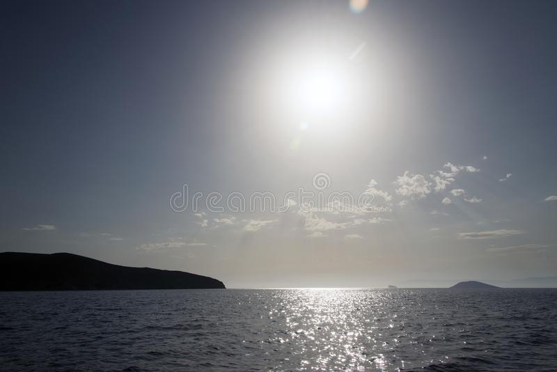 A view of a seascape and horizon under sunset in the island of Patmos, Greece royalty free stock photography