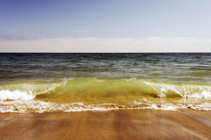A view of a seascape, Pacific ocean, waves and foams and splash in Malibu, California royalty free stock photography