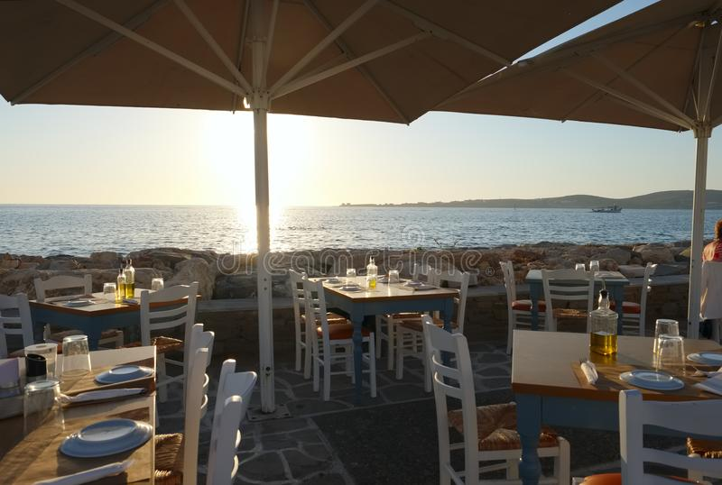 View from the seaside restaurant in Parikia village on Paros island at sunset, Cyclades royalty free stock photography