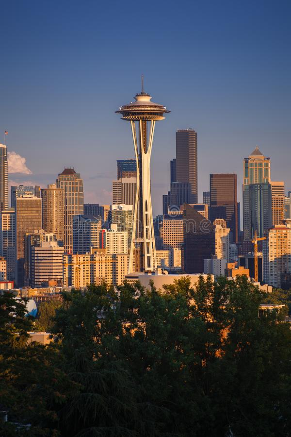 View on Seattle cityscape with Space Needle in front of skyscrapers, during early sunset with sunt hitting the buildings royalty free stock image